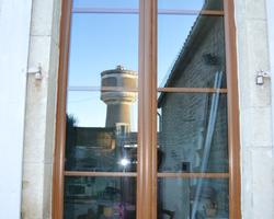 Menuiserie Gruet - Pothières - Porte fenêtre PVC 2 vantaux avec imposte fixe
