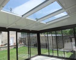 Menuiserie Gruet - Châtillon-sur-Seine - Véranda aluminium ouverture coulissante avec puits de lumière